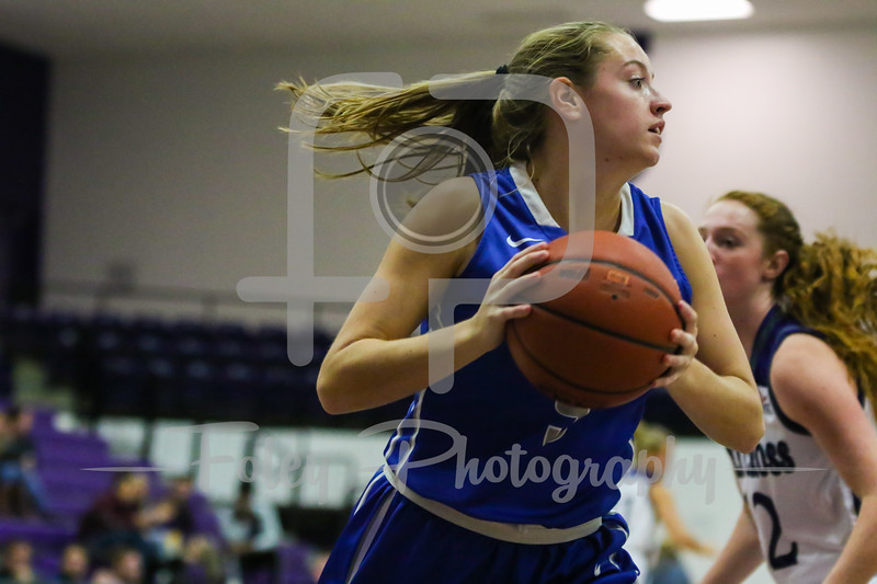 Assumption College guard Abby McKanna (5)