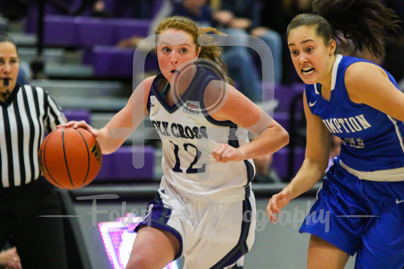 Holy Cross Crusaders guard Madalyn Smith (12) Assumption College guard Brittani LeBlanc (20)