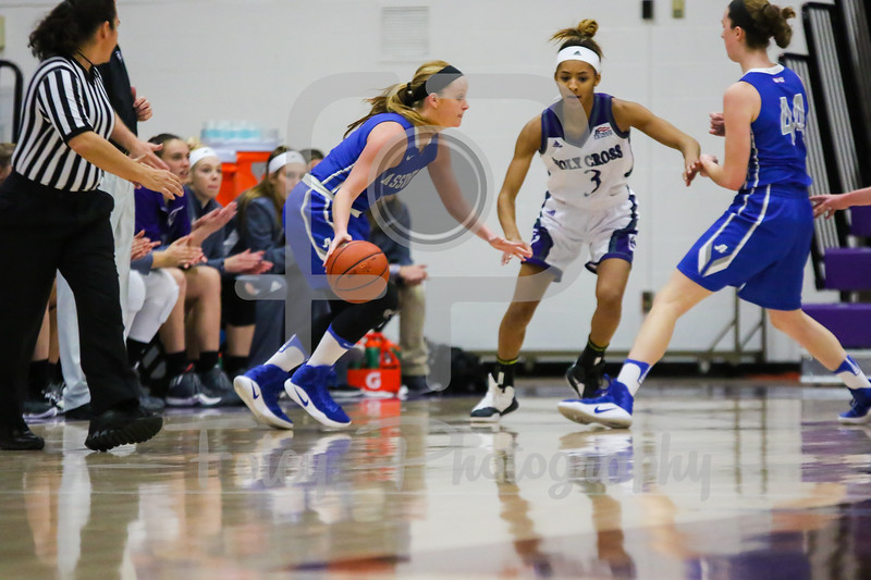 Sunday, November 6, 2016; Worcester, Massachusetts;  An Assumption College guard tries to get free during the Holy Cross Crusaders 62-55 victory over the Greyhounds.