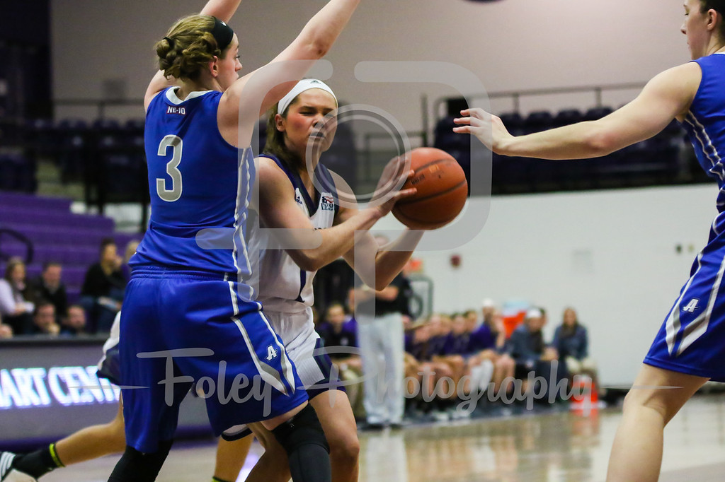 Holy Cross Crusaders guard Tricia Byrne (1) Assumption College guard Allison Stoddard (3)