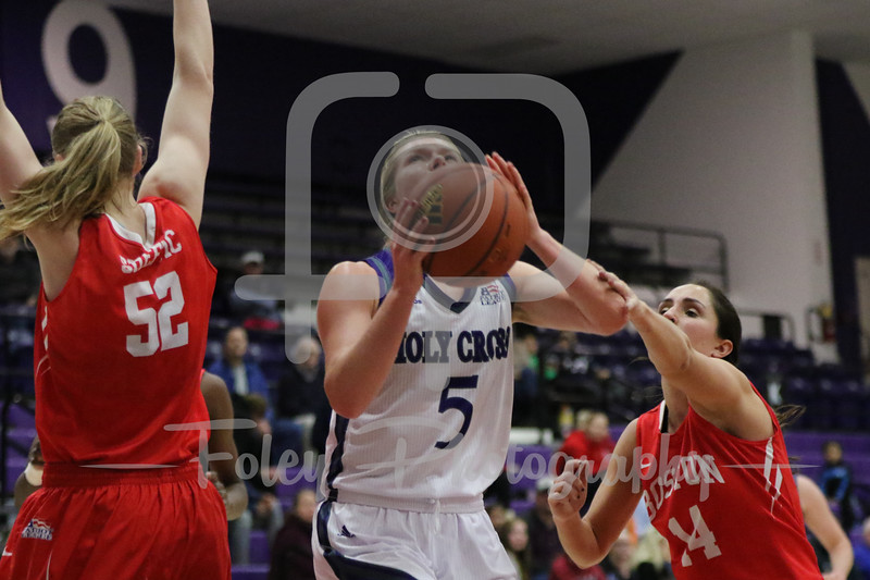 Holy Cross Crusaders guard Katie Doherty (5) Boston University Terriers guard Courtney Latham (14)