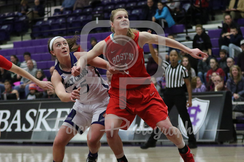 Holy Cross Crusaders guard/forward Madelyn Ganser (15) Boston University Terriers forward Kara Sheftic (52)