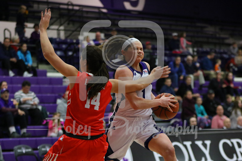 Holy Cross Crusaders guard Tricia Byrne (1) Boston University Terriers guard Courtney Latham (14)