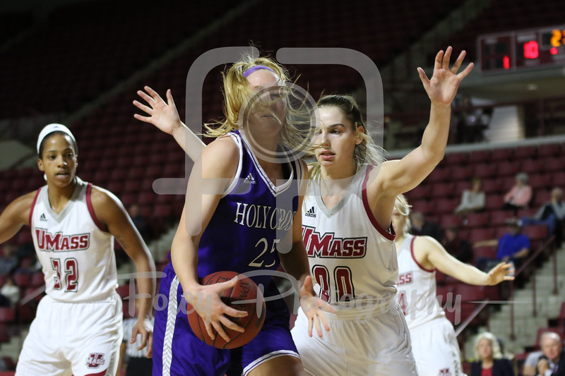 Holy Cross Crusaders forward Lauren Manis (25) Massachusetts Minutewomen forward/center Maggie Mulligan (00)
