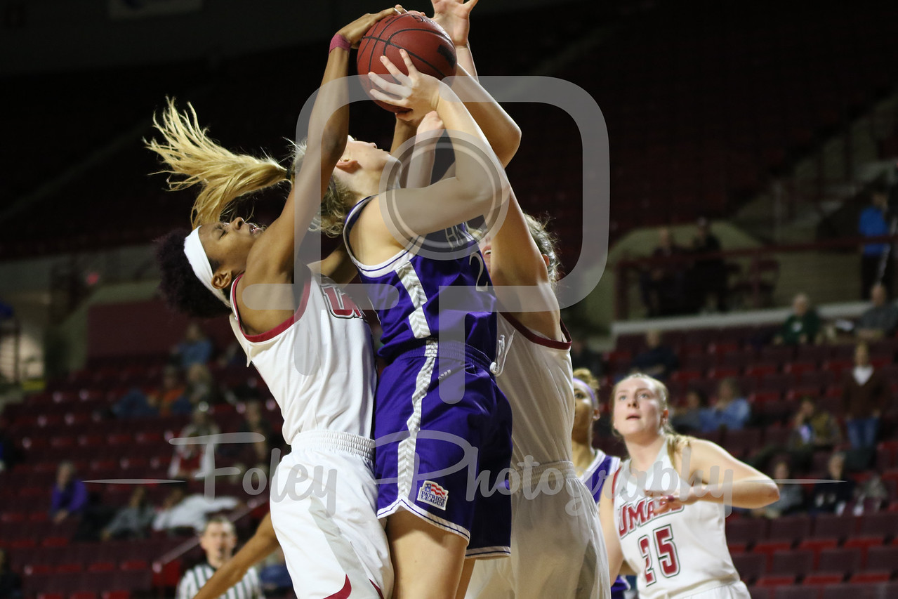Massachusetts Minutewomen guard Ryan Holder (2) Holy Cross Crusaders forward Lauren Manis (25)