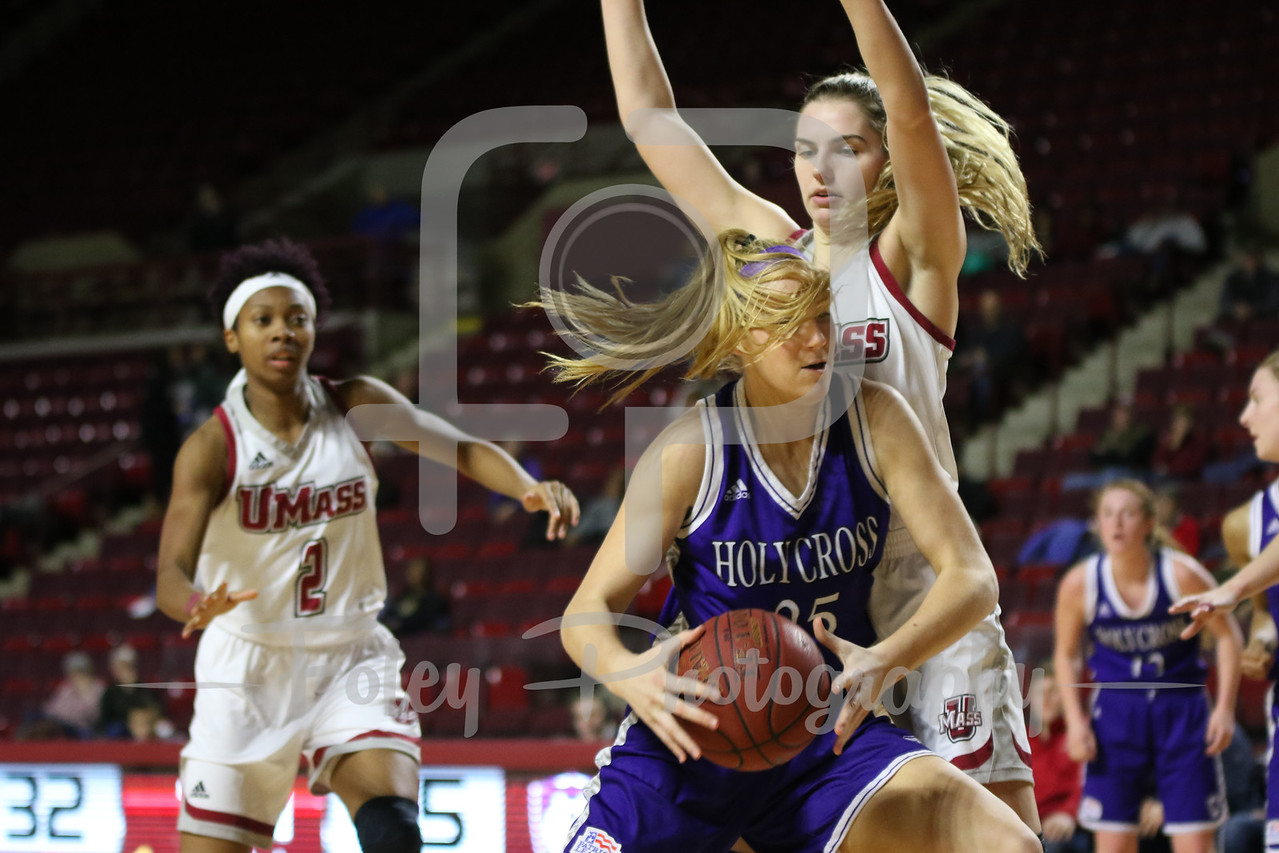 Massachusetts Minutewomen forward/center Maggie Mulligan (00) Holy Cross Crusaders forward Lauren Manis (25)