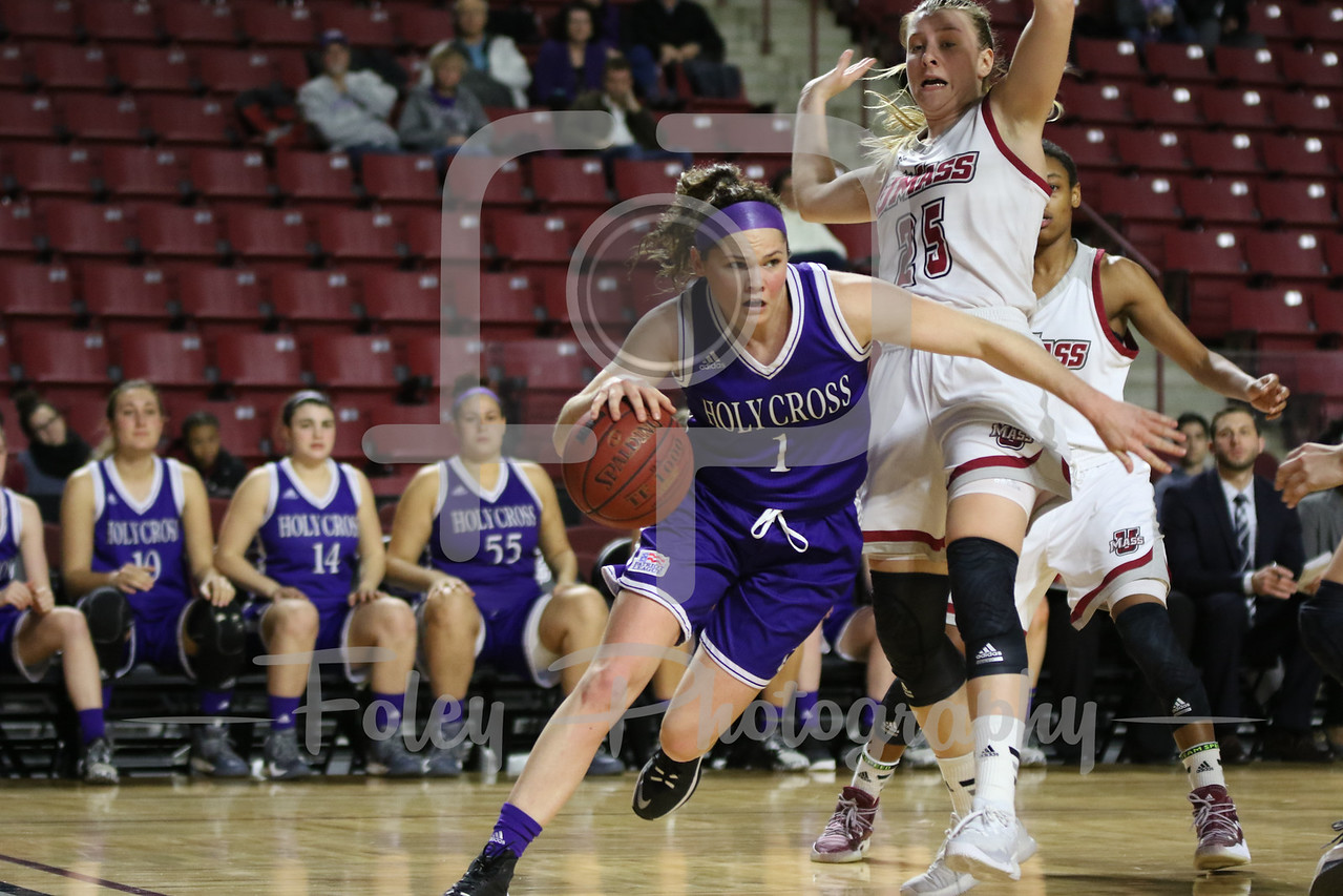 Holy Cross Crusaders guard Tricia Byrne (1) Massachusetts Minutewomen guard Leah McDerment (25)