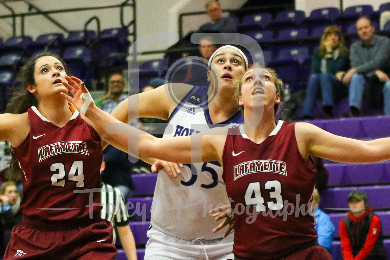 Holy Cross Crusaders center Miranda Nixon (55) Lafayette Leopards forward Ashley Lutz (43)