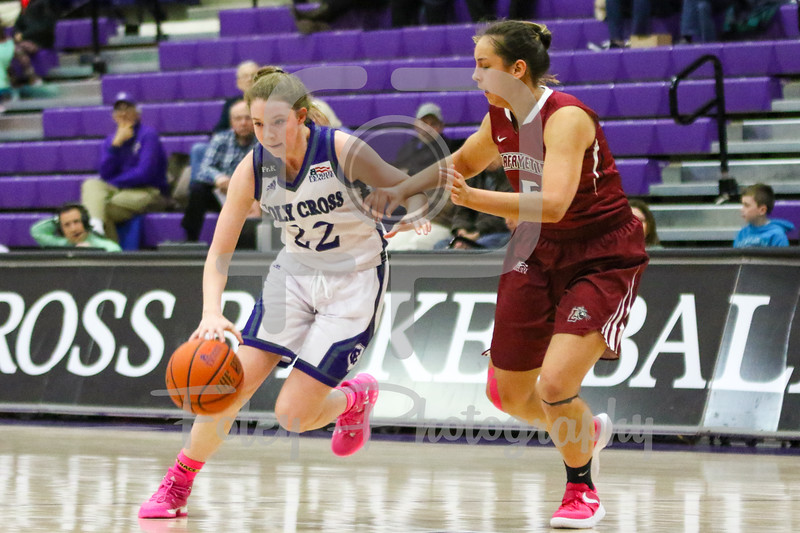 Holy Cross Crusaders guard Madalyn Smith (12)