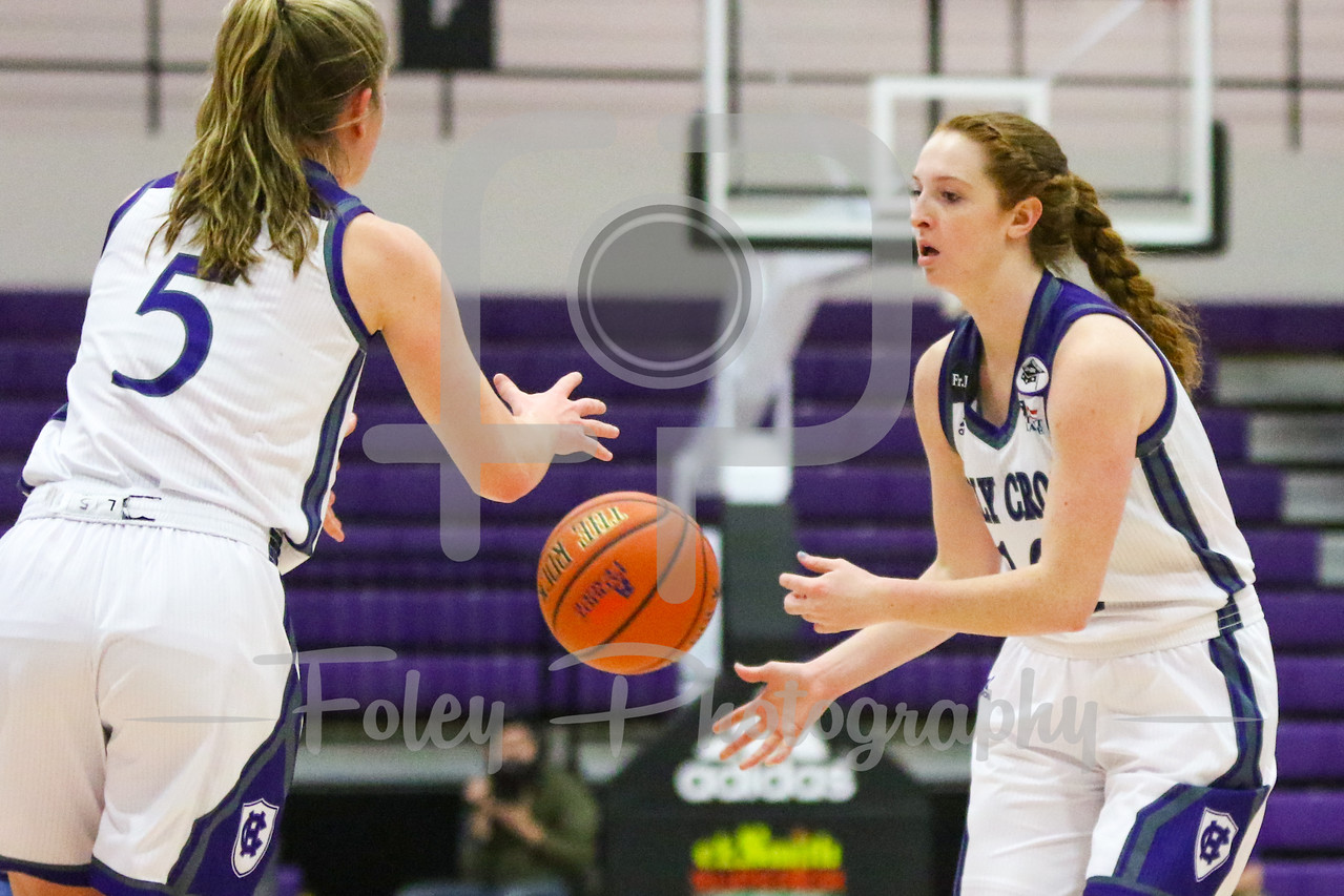 Holy Cross Crusaders guard Madalyn Smith (12) Holy Cross Crusaders guard Katie Doherty (5)