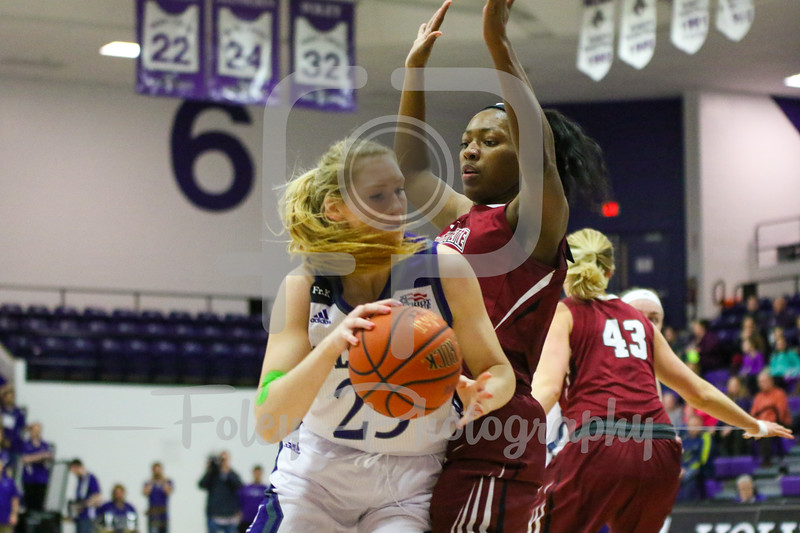 Holy Cross Crusaders forward Lauren Manis (25) Lafayette Leopards guard/forward Olivia Gumbs (0)