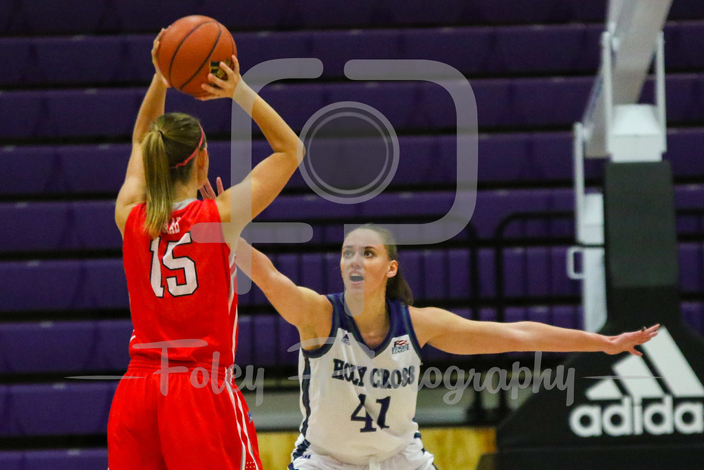Holy Cross Crusaders forward Amy Hasenauer (41) Marist Red Foxes forward Kendall Baab (15)
