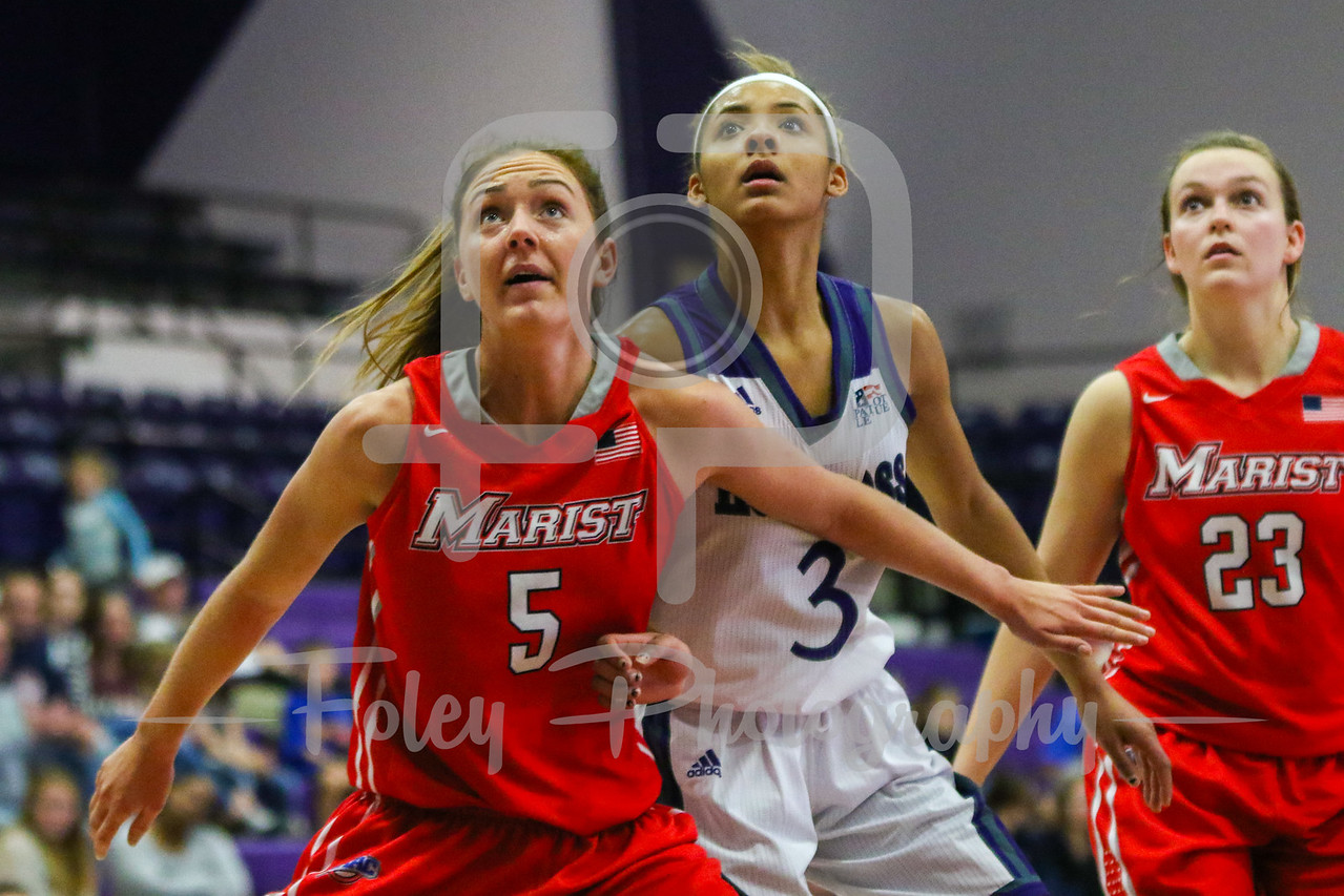 Marist Red Foxes forward Lovisa Bjort Henningsdottir (5) Holy Cross Crusaders guard Infiniti Thomas-Waheed (3)