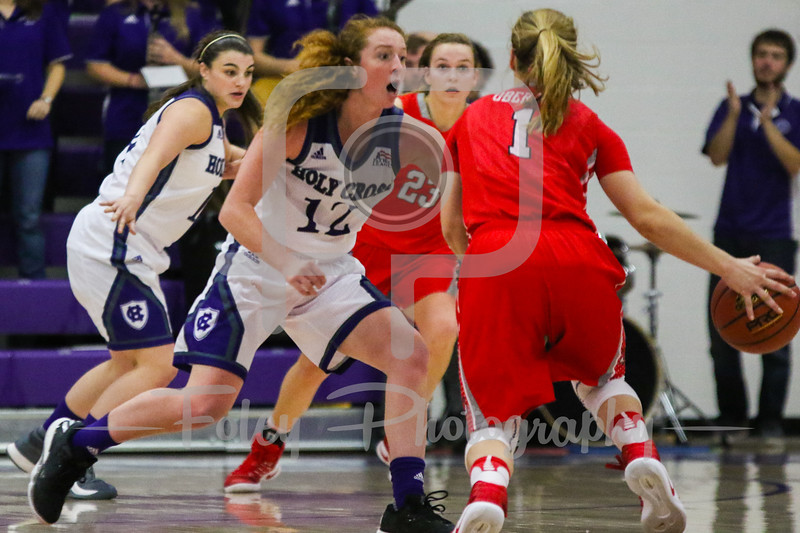 Holy Cross Crusaders guard Madalyn Smith (12) Marist Red Foxes guard Claire Oberdorf (1)