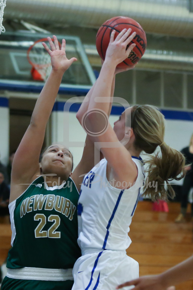 Becker College Hawks forward Micaela Rice (14) Newbury College Nighthawks Savannah Olsen (22)