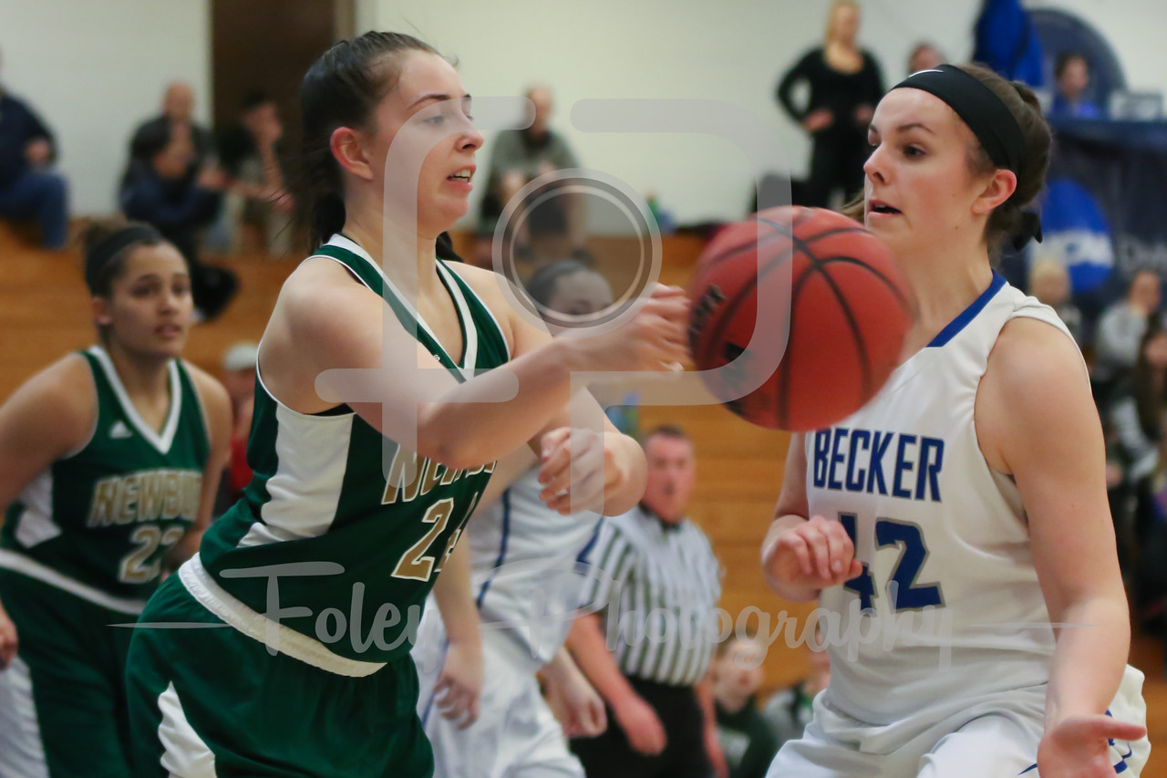 Newbury College Nighthawks Taylor Kelley (24) Becker College Hawks forward Sarah Ware (42)