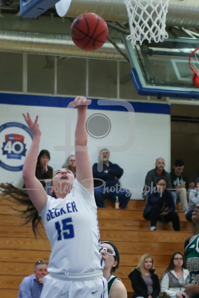 Becker College Hawks guard Kelsey Maynard (15)