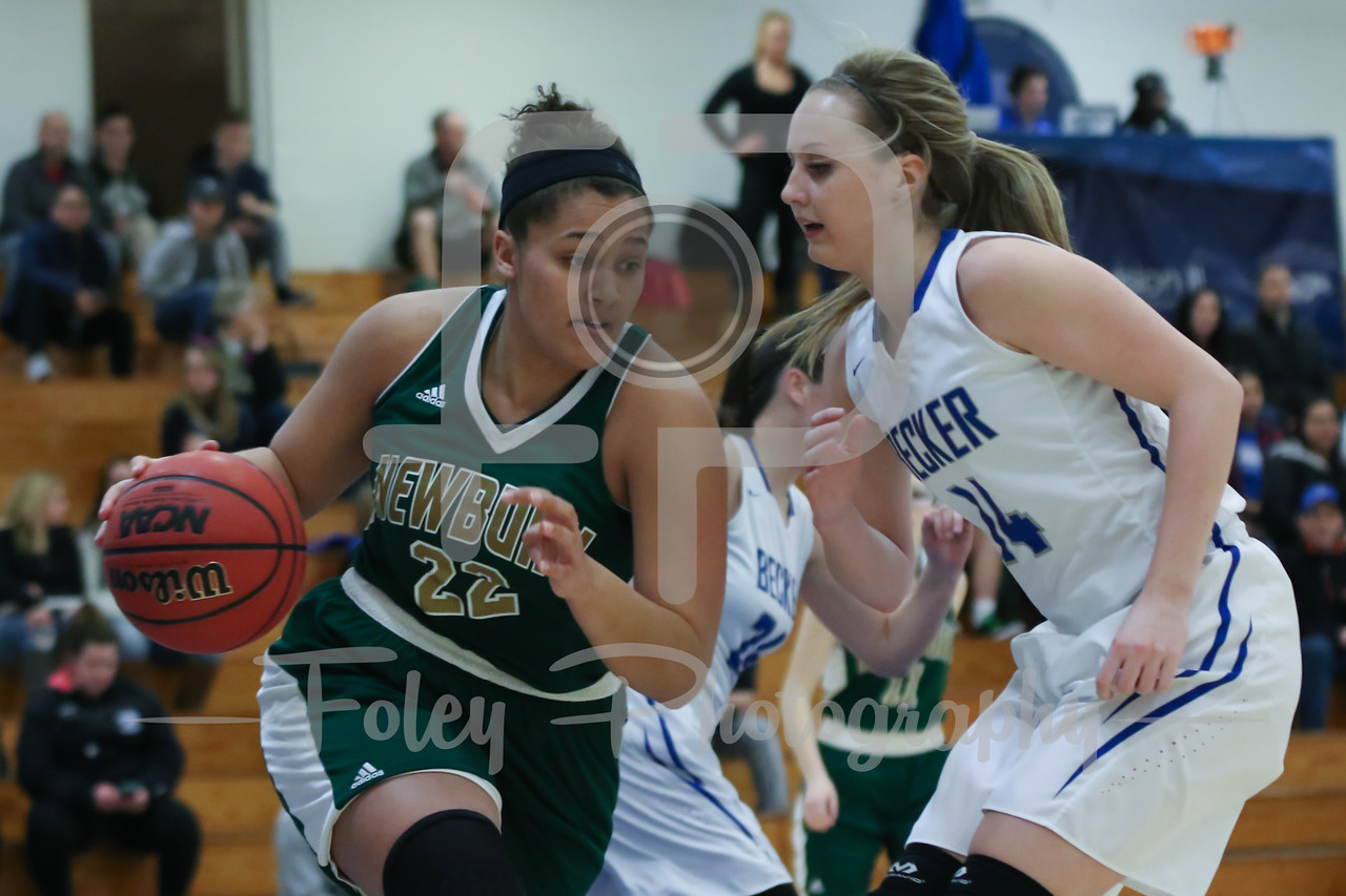 Newbury College Nighthawks Savannah Olsen (22) Becker College Hawks forward Micaela Rice (14)