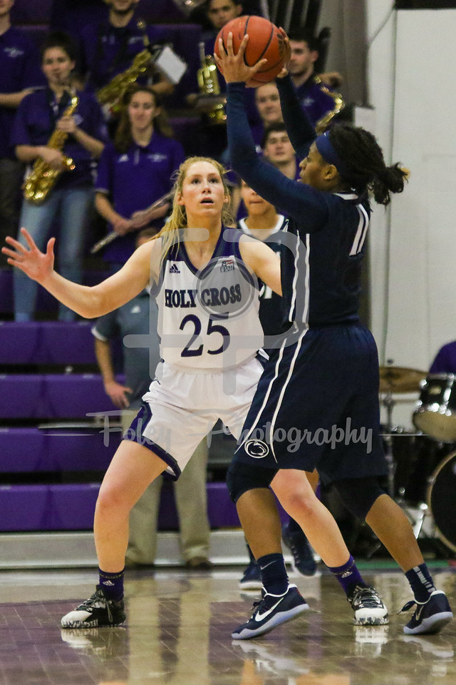 Holy Cross Crusaders forward Lauren Manis (25) Penn State Lady Lions guard Teniya Page (11)