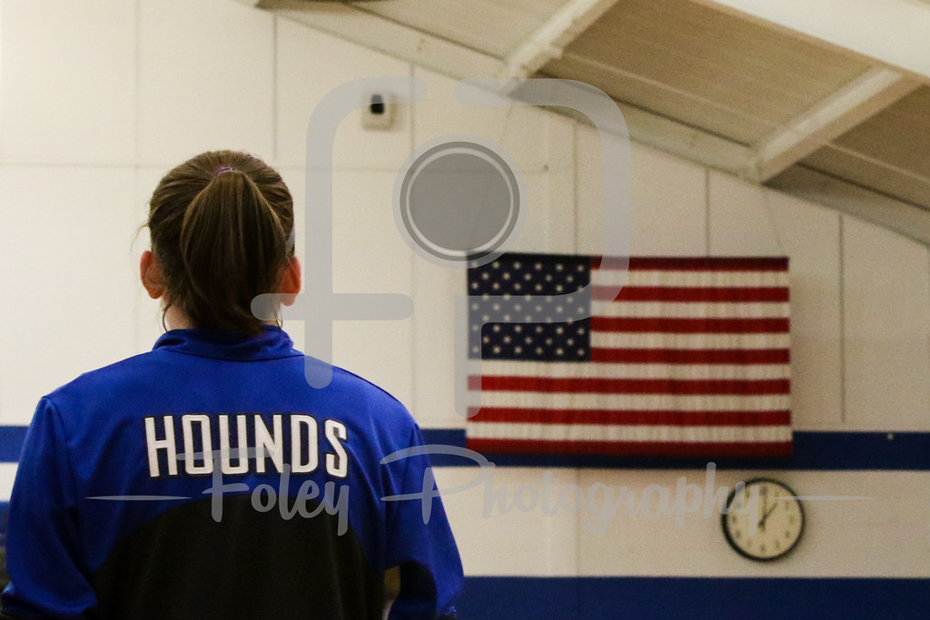 Assumption College player listens to the Anthem