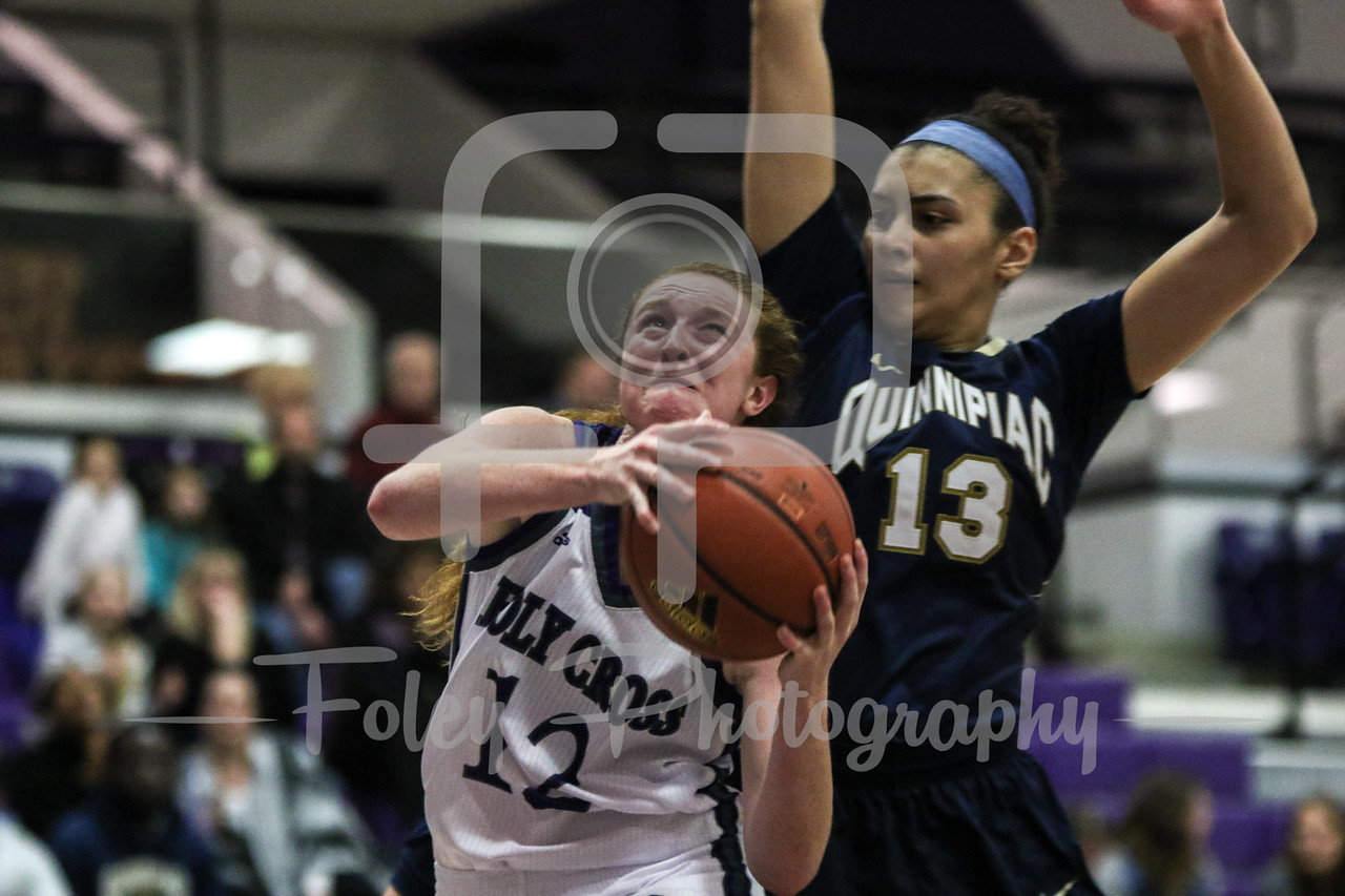 Holy Cross Crusaders guard Madalyn Smith (12) Quinnipiac Bobcats forward Sarah Shewan (13)