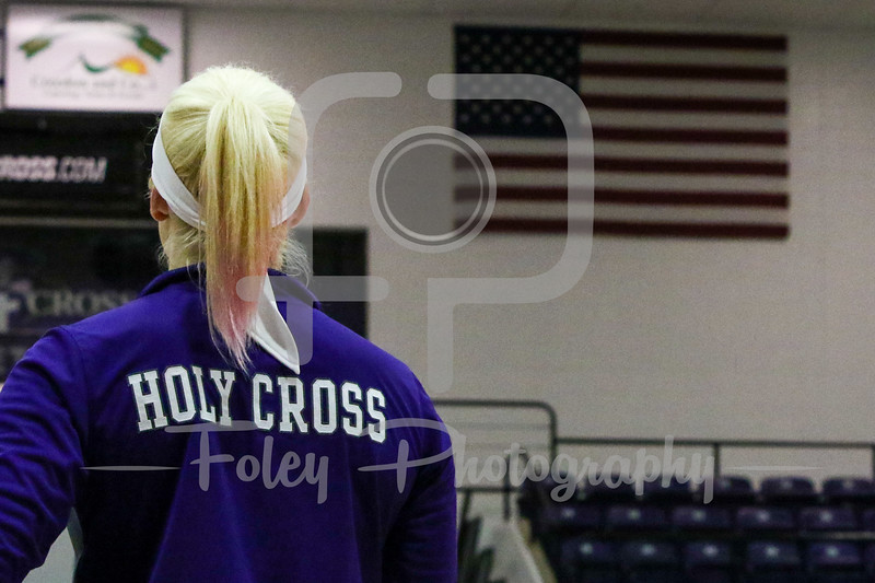 Holy Cross Crusaders Players listens to the Anthem