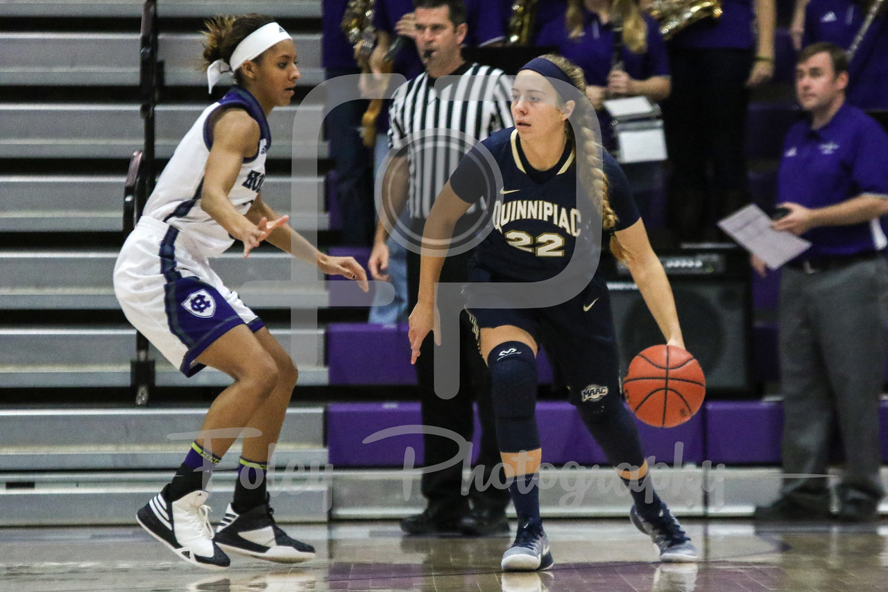 Quinnipiac Bobcats guard Brittany Johnson (22) Holy Cross Crusaders guard Infiniti Thomas-Waheed (3)