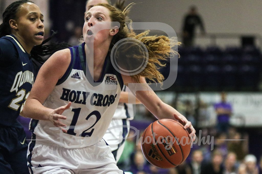 Holy Cross Crusaders guard Madalyn Smith (12) Quinnipiac Bobcats guard Brittany Johnson (22)