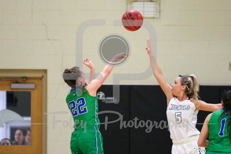 Salve Regina Kerri Beland (22) Nichols College forward Brooke Packard (5)