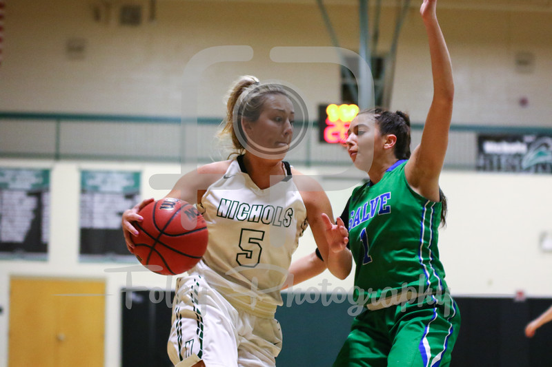 Nichols College forward Brooke Packard (5) Salve Regina guard Torie Scorpio (1)