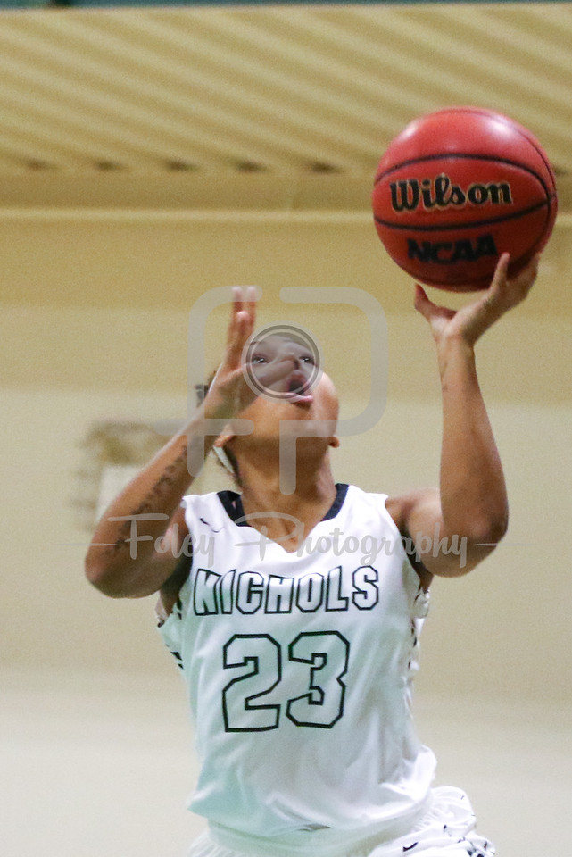 Nichols College guard Callie Andrews (23)
