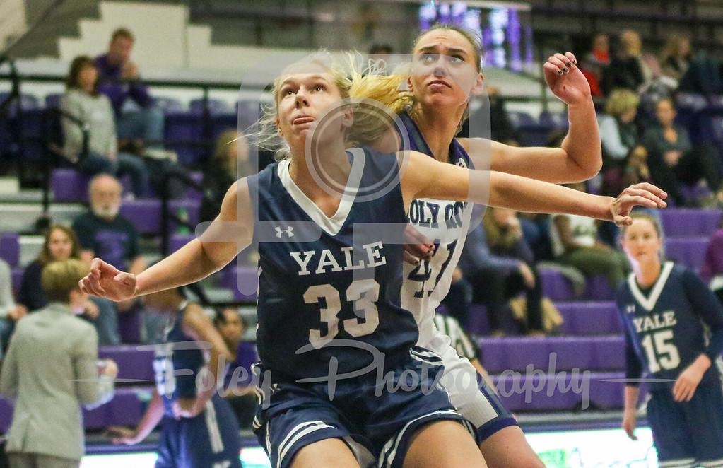 Yale Bulldogs forward Elizabeth Haley (33) Holy Cross Crusaders forward Amy Hasenauer (41)