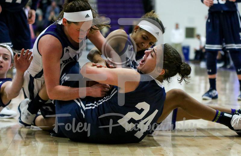 Holy Cross Crusaders guard Tricia Byrne (1) Yale Bulldogs guard Lena Munzer (24)
