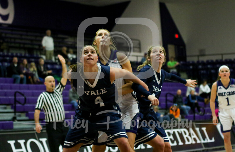 Yale Bulldogs guard Megan Gorman (4) Holy Cross Crusaders forward Lauren Manis (25)