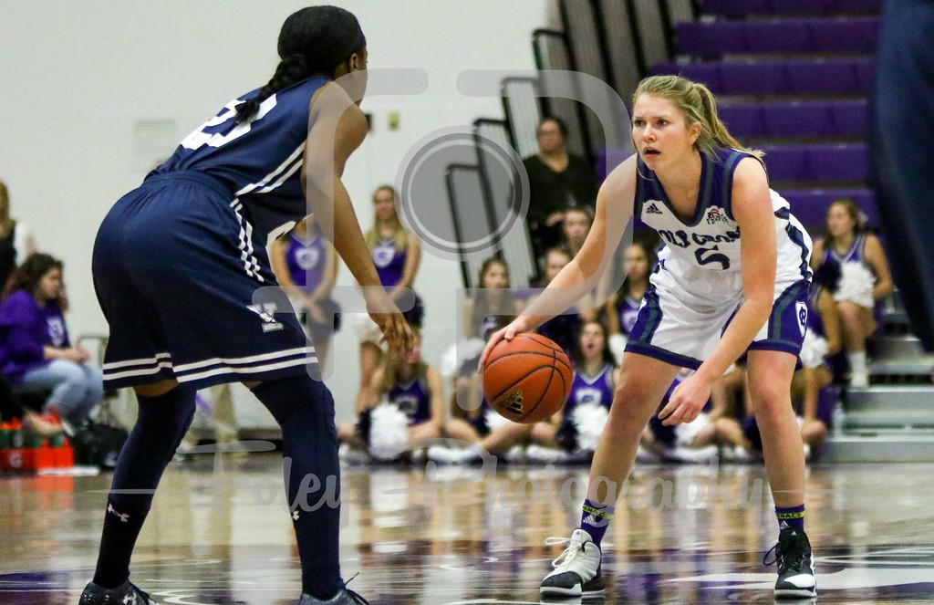 Holy Cross Crusaders guard Katie Doherty (5) Yale Bulldogs guard Tamara Simpson (23)