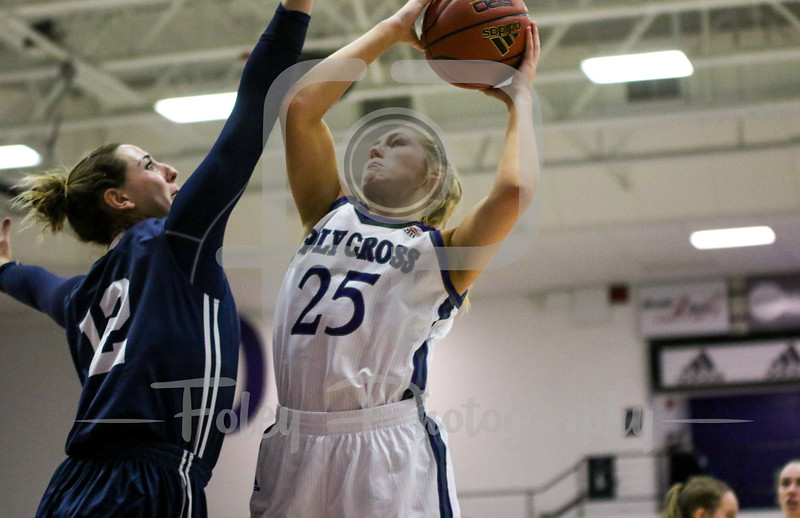 Holy Cross Crusaders forward Lauren Manis (25) Yale Bulldogs forward Jen Berkowitz (12)