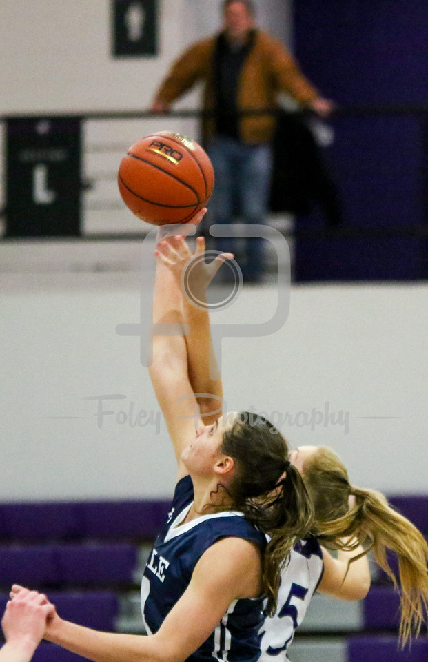 Sunday, November 27, 2016; Worcester, Massachusetts; The opening tip of overtime between Yale Bulldogs and Holy Cross Crusaders during the Bulldogs 71-70 overtime victory over the Crusaders.
