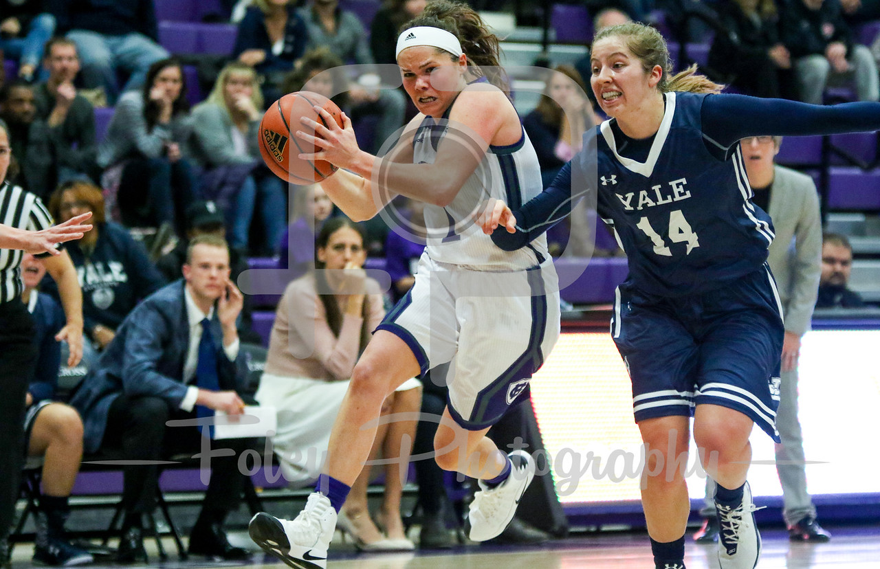 Holy Cross Crusaders guard Tricia Byrne (1) Yale Bulldogs guard Mary Ann Santucci (14)