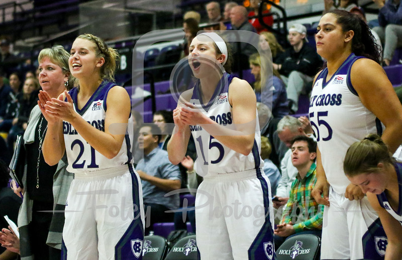 Holy Cross Crusaders guard Madison Springfield (21) Holy Cross Crusaders guard/forward Madelyn Ganser (15) Holy Cross Crusaders center Miranda Nixon (55)