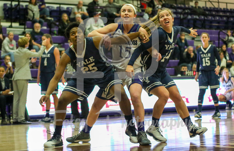 Yale Bulldogs forward Alexandra Maund (25) Holy Cross Crusaders guard/forward Madelyn Ganser (15)