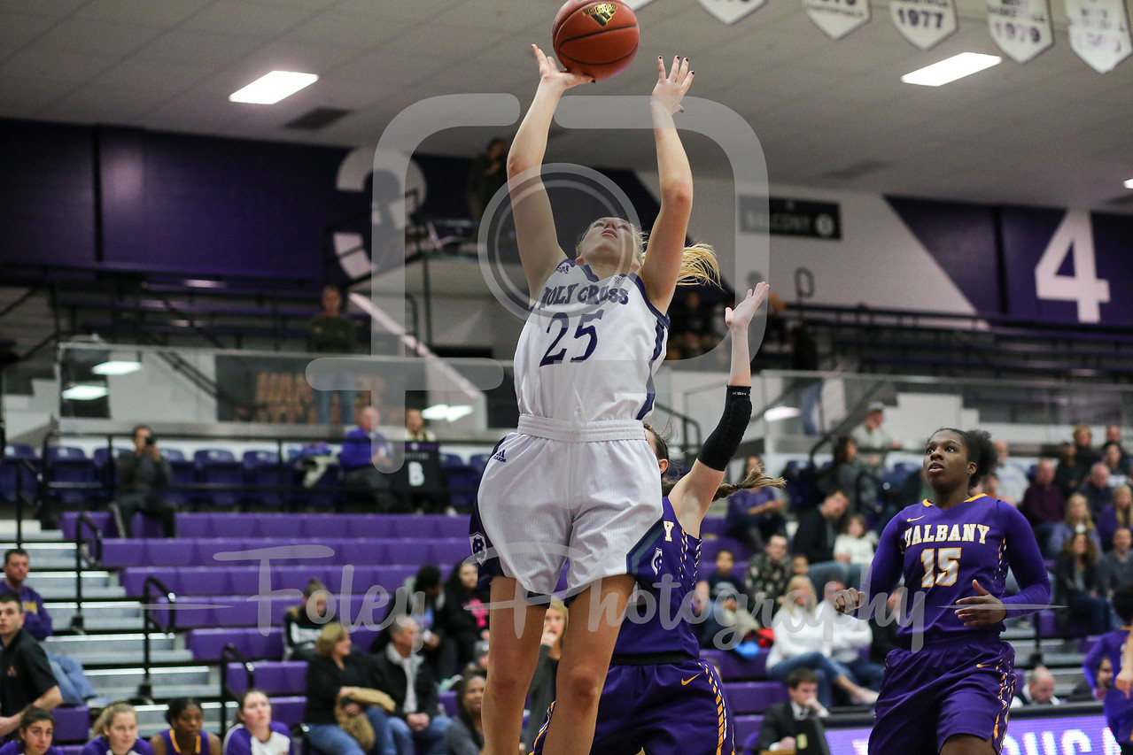 Lauren Manis (25) of the Holy Cross Crusaders