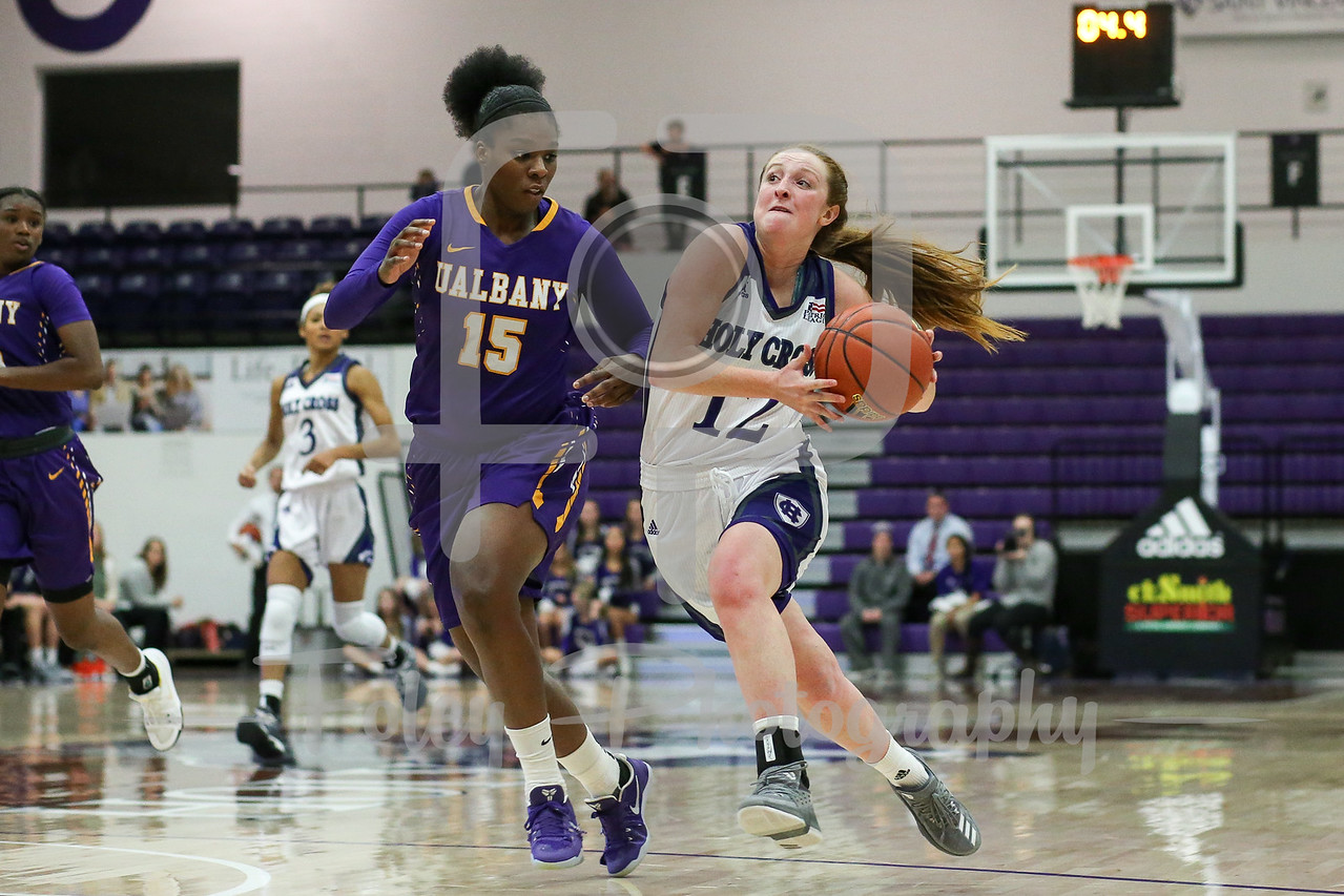 Madalyn Smith (12) of the Holy Cross Crusaders Jessica Fequiere (15) of the Albany Great Danes