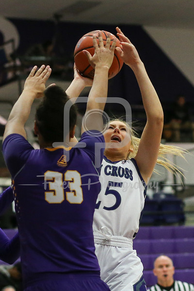 Lauren Manis (25) of the Holy Cross Crusaders Tiana-Jo Carter (33) of the Albany Great Danes