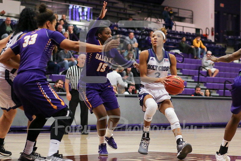 Infiniti Thomas-Waheed (3) of the Holy Cross Crusaders Jessica Fequiere (15) of the Albany Great Danes