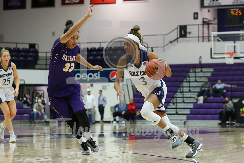 Infiniti Thomas-Waheed (3) of the Holy Cross Crusaders Tiana-Jo Carter (33) of the Albany Great Danes