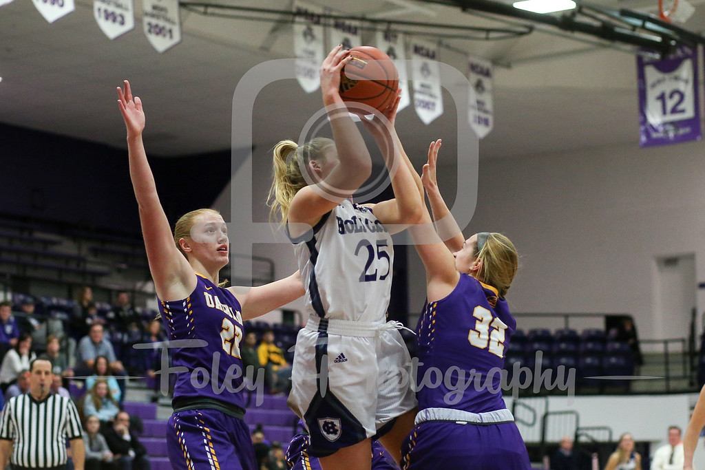 Lauren Manis (25) of the Holy Cross Crusaders Emma List (32) of the Albany Great Danes