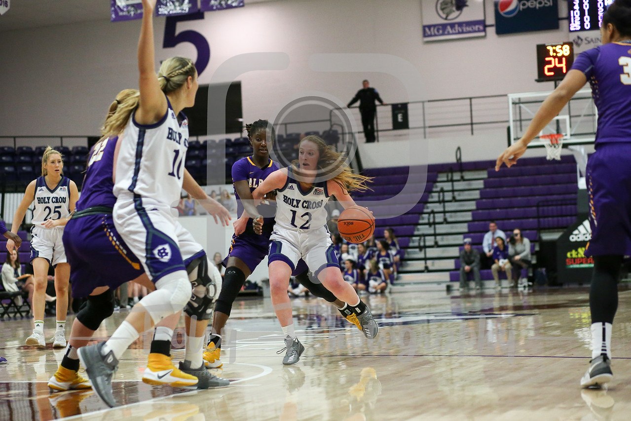 Madalyn Smith (12) of the Holy Cross Crusaders Bose Aiyalogbe (13) of the Albany Great Danes