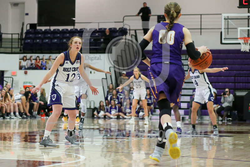 Madalyn Smith (12) of the Holy Cross Crusaders Mackenzie Trpcic (00) of the Albany Great Danes