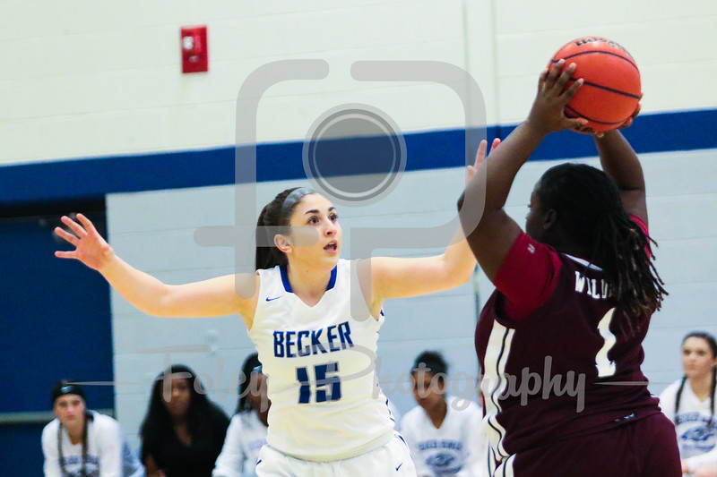 Becker College Hawks guard Kelsey Maynard (15)