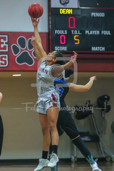 Dean College Bulldogs Shannon Rosensteel (5) Becker College Hawks forward Adrianna Dowdy (13)